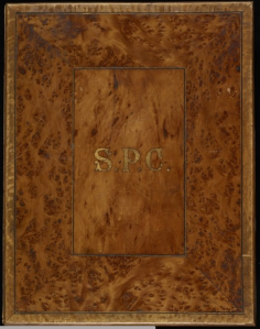 The mottled kauri cover of the illuminated address for Wallis.